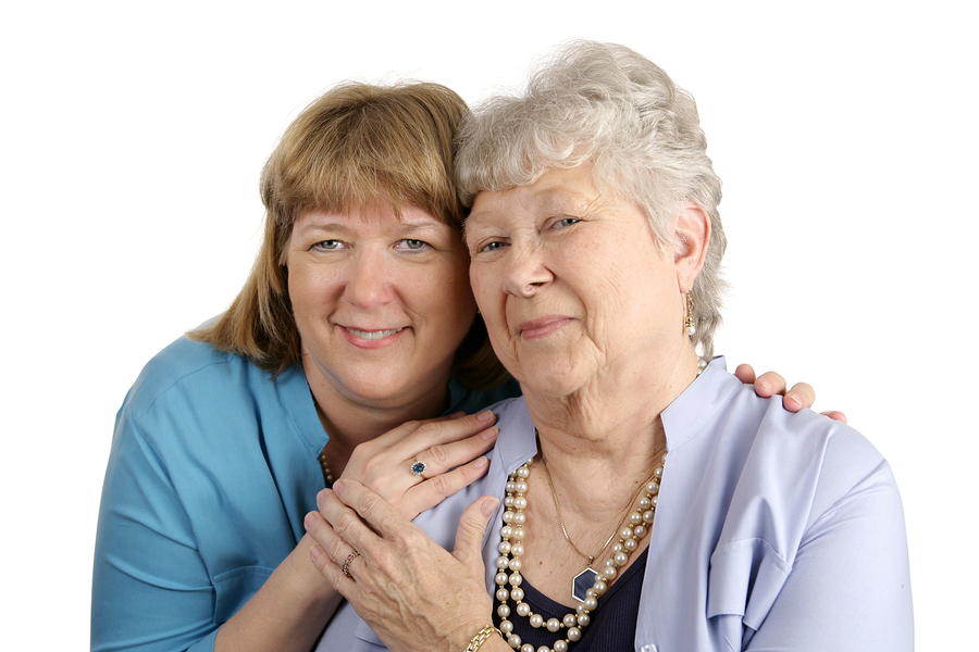 A portrait of an adult daughter and elderly mother with mixed emotions due to their struggle to get along.